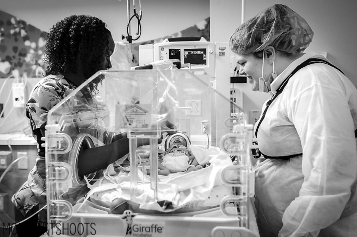 Pictured: NICU nurse at Norton Women's & Children's Hospital discusses care measures for one of Amanda and Lauren Vinova's preemie triplets.