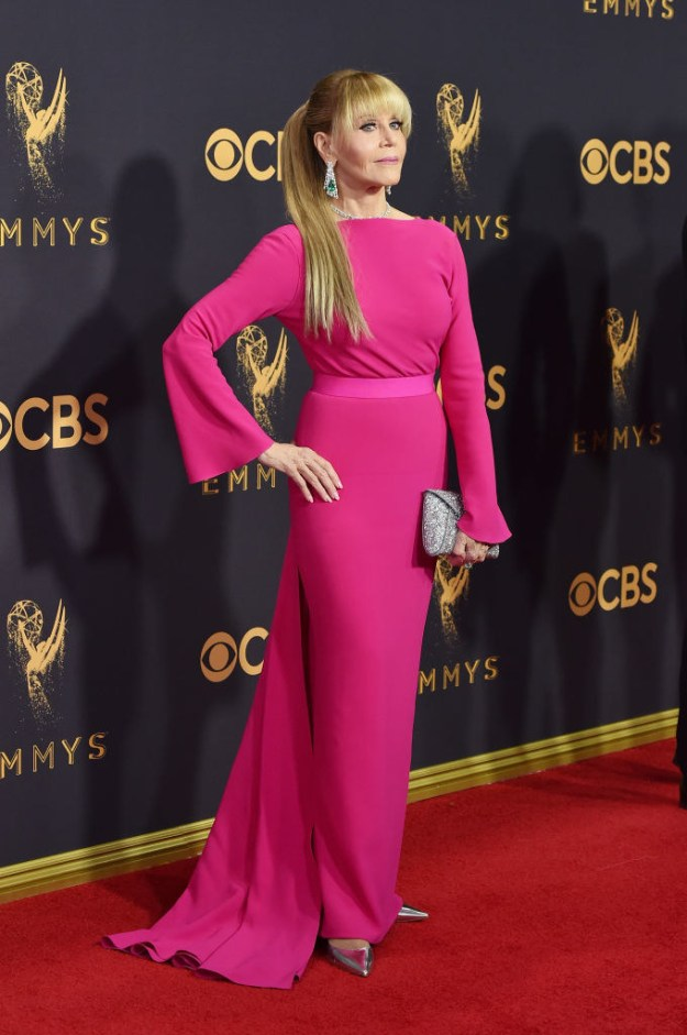 SHE'S ROCKING THAT HOT PINK GOWN.