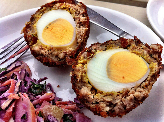 A boiled egg coated in sausage meat and breadcrumbs may sound super weird, but it's actually a good snack to bring to a picnic.