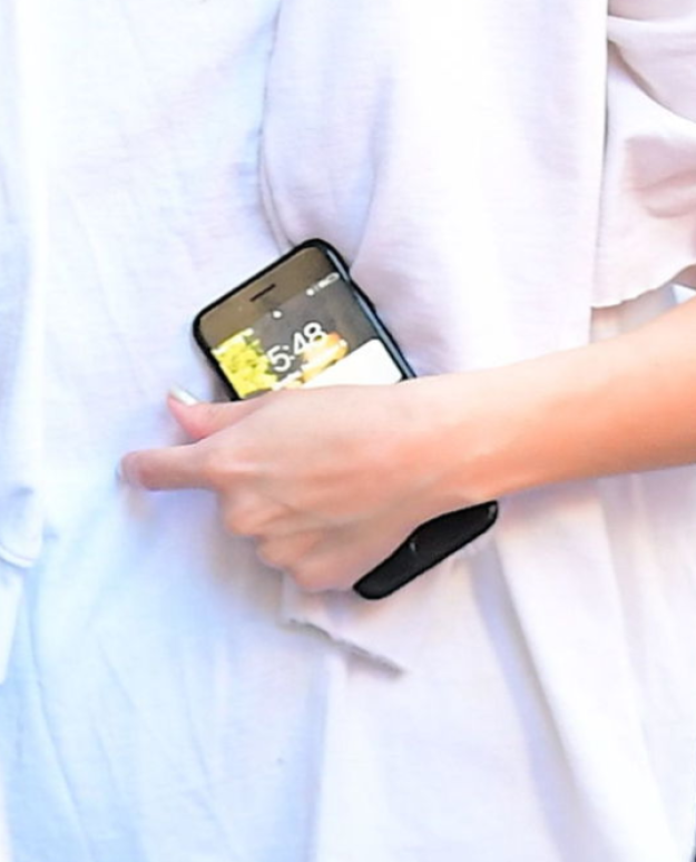 ...but if you look a little closer at this photo evidence, taken at precisely 5:48, you'll notice that Selena's phone background is actually a sweet tribute to The Weeknd.