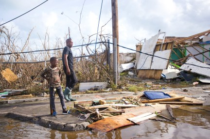 People inspect the damage in Marigot.