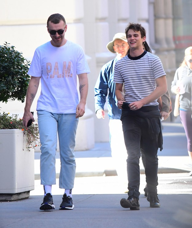 Here's awesome human being and singing legend Sam Smith walking along happily with fellow awesome human being and 13 Reasons Why actor Brandon Flynn.