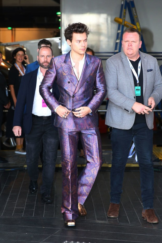 Shiny purple paisley suit: Iconic.