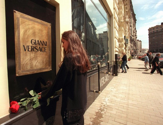 A sales associate at the Versace store in Moscow placed a flower under the shop's entrance sign.