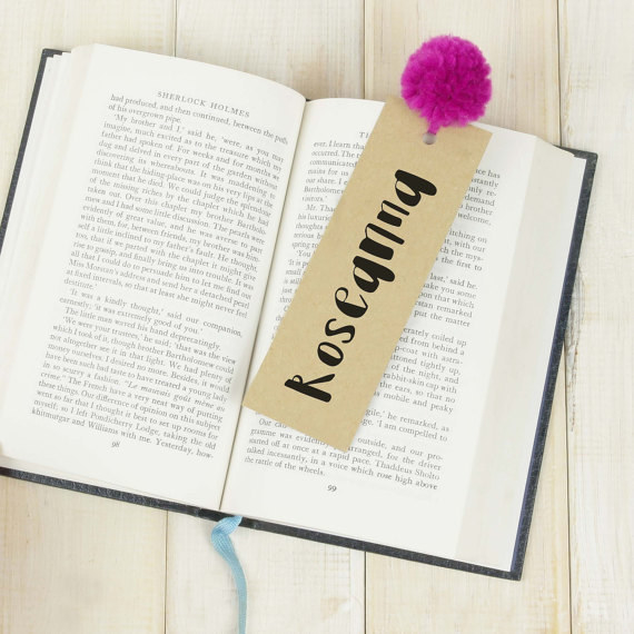 Or use this cute personalised pom-pom bookmark.
