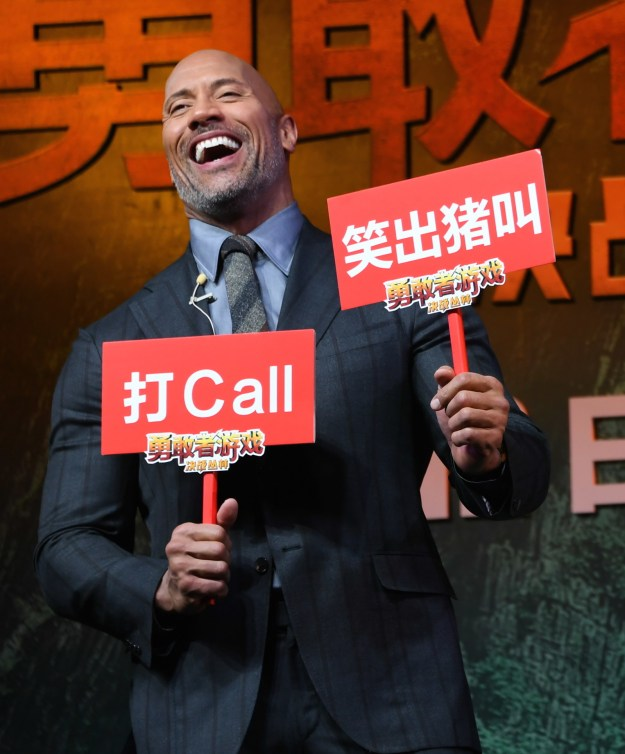 The Rock chuckled at the premiere of Jumanji: Welcome to the Jungle in Beijing.
