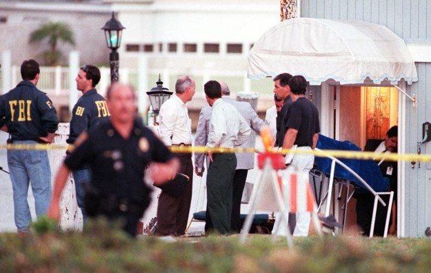 After entering and securing the premises, medical examiners removed a body from the houseboat.