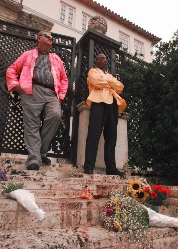 Police tape gone, private security stood outside the gates of Versace's home as fans began to leave gifts for the slain designer.