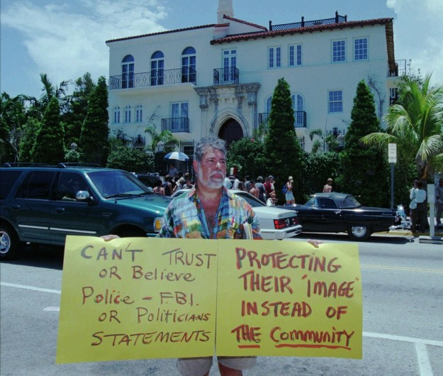 On July 17, people continued to surround the Versace property on Ocean Drive.