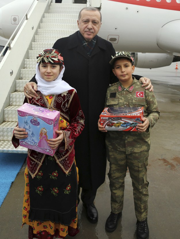 It was neither the first nor last the time Erdogan had taken photo ops with children dressed in Turkish military gear over the last few days. Here he is in the province of Sanliurfa on Sunday before another party speech.