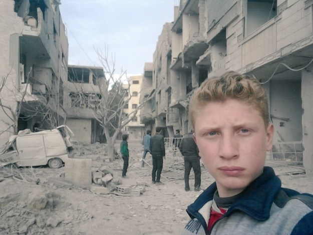This is Muhammad Najem. According to his Twitter account he's a 15-year-old boy living in Eastern Ghouta, Syria.