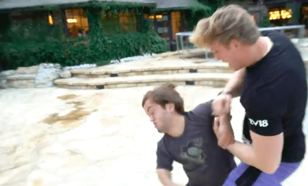 In his new video, Paul returns to his home and then begins a mock fight.