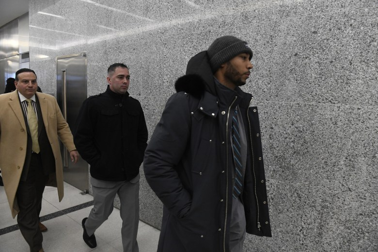 Former NYPD Detectives Eddie Martins (center) and Richard Hall (right) leaving Kings County Supreme Court in January.