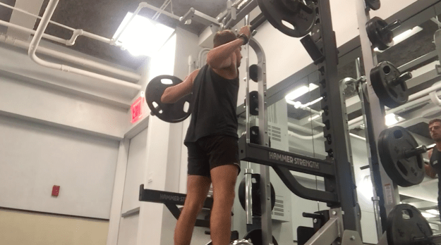 Since Spencer already works out six times a week, he knew he could do the squats without a problem. So, he added weights to his squats to present more of a challenge.
