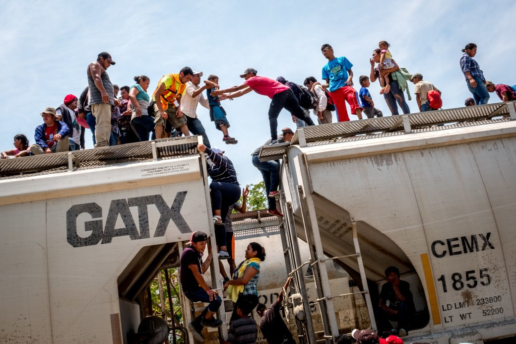 "Migrants practice boarding ""La Bestia,"" the infamously dangerous train that will carry them toward the US border."