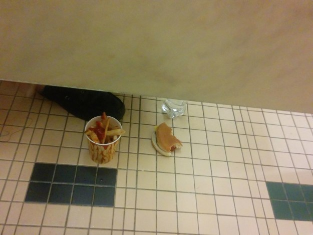 This person who has a lot of faith in the cleanliness of this public restroom.