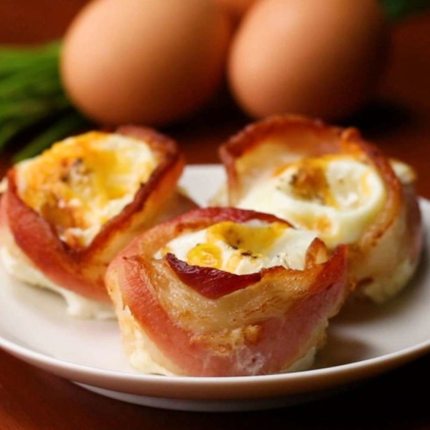 Swoon-worthy bacon egg cups that'll basically done in two simple steps – station the bacon in the muffin tin, bake, and then crack and egg into it.