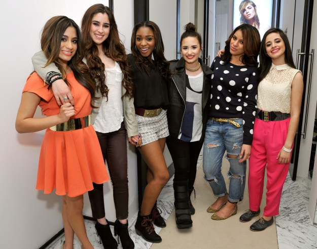 X Factor judge Demi Lovato posed with Fifth Harmony (all contestants on the show) at a Topshop event in some very 2013 lewks.