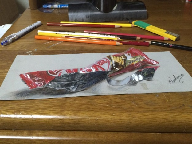 The bottle is one of a number of 3D drawings he has done. He started three years ago with this Kit-Kat wrapper.