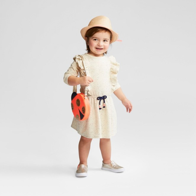 """Promising review: """"LOVE the pockets! The dress is a heavier fabric and the sleeves are full length. """" —toddlermommaGet it from Target for $10.18 (available in sizes 12M-5T)."""