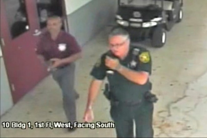 Scot Peterson is seen in this still image captured from the school surveillance video