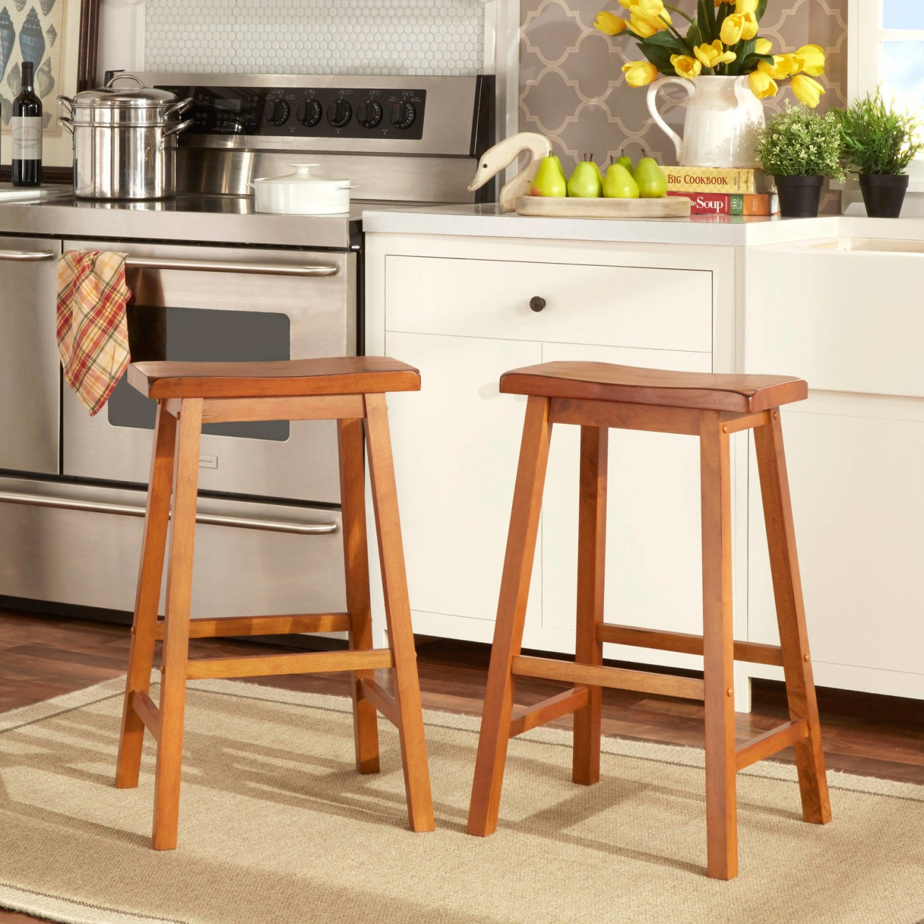 "Promising review: ""I am very happy with these stools! They were quite simple to assemble with the tools provided — it took me less than 30 minutes. They are solid wood, very sturdy, and they look great at my kitchen breakfast bar. The seats are wide enough to be comfortable. You just can't beat these stools for the price! I saw them on other sites for  each and you had to pay shipping on those, too. The stools arrived a week before the estimated delivery. —DavenportJPPrice: .46+ (available in three sizes)"