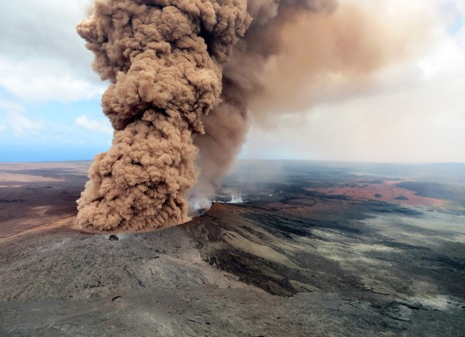 A column of reddish-brown ash erupts from Hawaii's Kilauea volcano on May 4.