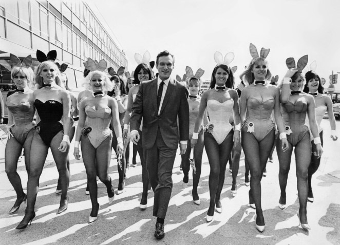 Playboy founder Hugh Hefner arrives at the London Airport from Chicago with an entourage of Playboy Bunnies on June 26, 1966.