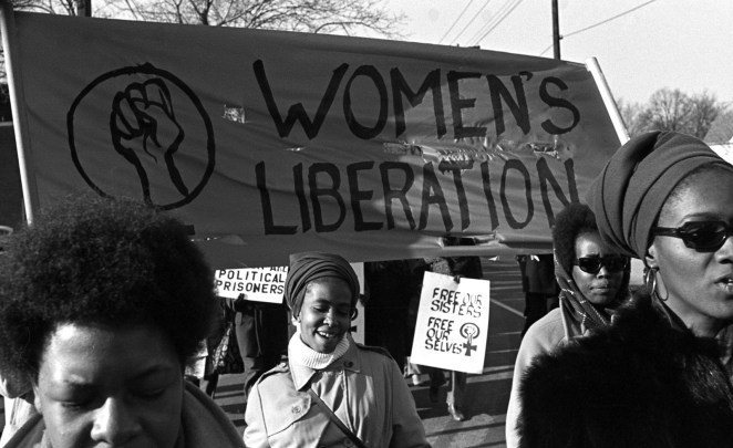 "A group of women march under a ""women's liberation"" banner and in support of the Black Panther Party in New Haven, Connecticut, in 1969."