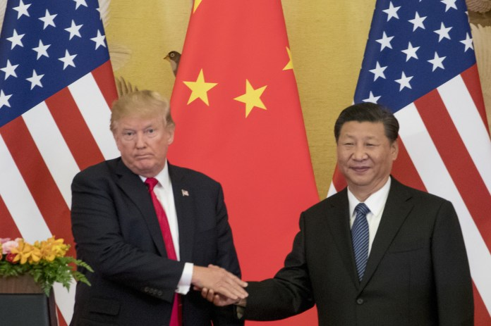 President Donald Trump and Chinese President Xi Jinping in Beijing's Great Hall of the People.