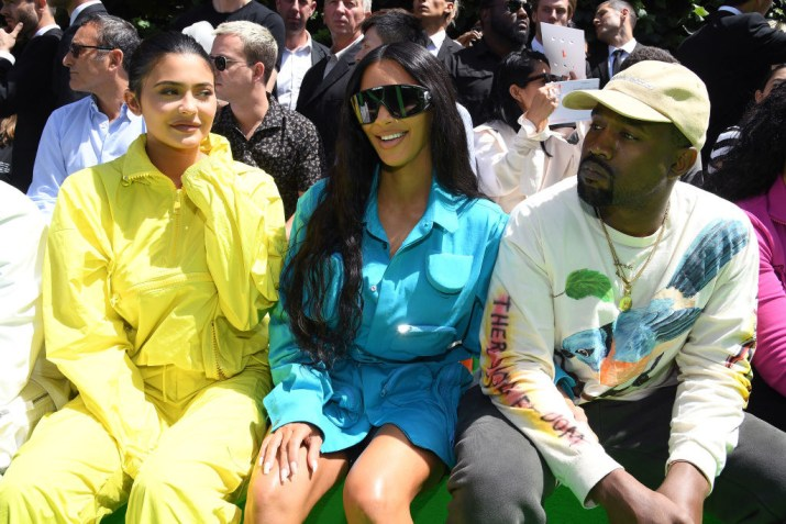 (Left to right) Kylie Jenner, Kim Kardashian and Kanye West attend the Louis Vuitton Menswear Spring/Summer 2019 show.