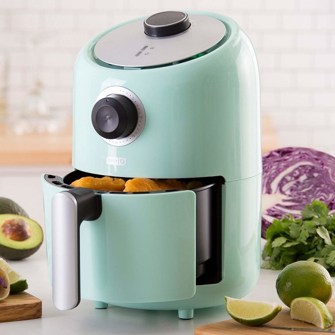 """""""Air fryer! I have a Crock Pot and Instant Pot but I only use them maybe once or twice a month. The air fryer gets used at least three or four times a week by myself or my boyfriend. It's awesome for frozen or fresh food and is a life saver in the summer when it's a million degrees in the kitchen. I got this one and the size works well for two people. [Ed. note: the one pictured and linked here!]""""—sara72121""""I use mine several times a week. I live for French fries and this way I can have a smaller portion with way less calories. Plus, it's the only way I've found too cook them at home to taste as good as a restaurant. And it's great for veggie burgers, tots, chicken strips, and so much more!!""""—unconstructivecomment""""I live in Oklahoma which can get hot in the summer. I frequently make sweet potatoes for my dogs, or a baked potato for myself, because I hate heating up the oven for a couple of potatoes. It is also perfect for making pork chops or chicken strips. Everything cooks so quick. The most useful product of the year.""""—gaylajReviewers for this air fryer say it's perfect for everything from mozzarella sticks to wings to sweet potato fries. Get it on Amazon for $57.91. If you want to make bigger batches of things, consider upgrading to the Phillips, which is $199 on Amazon — read our review of that option."""