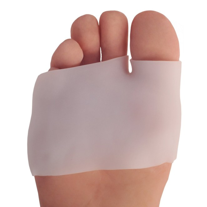 """Promising review: """"These were very useful for me after I developed a nasty blister and callous on the ball of my foot, right below my big toe. I hike a lot, and with the new hiking shoes I bought, my feet took a pounding. The only thing that doesn't quit work is the pad pulling off of the four smaller toes and getting wound up into a tighter wad between the toes and the sock. I resolved this by cutting that portion off entirely, and just keeping the foot pad and big toe holder. It seems to work better for me that way."""" —SabsterGet it from Amazon for $12.99."""