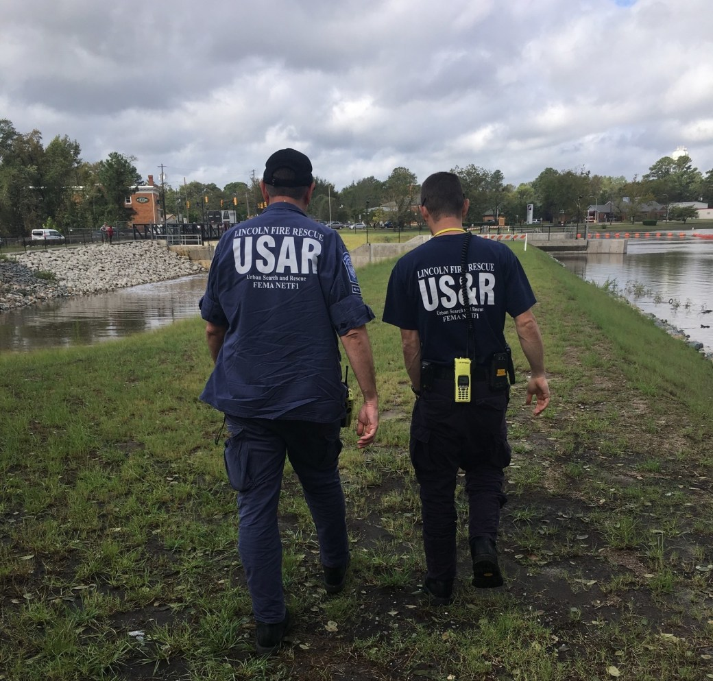 Shane Hennessey, left, and Dan Ripley of a FEMA search and rescue team checked on the status of Hope Mills dam following days of rain from Hurricane Florence.