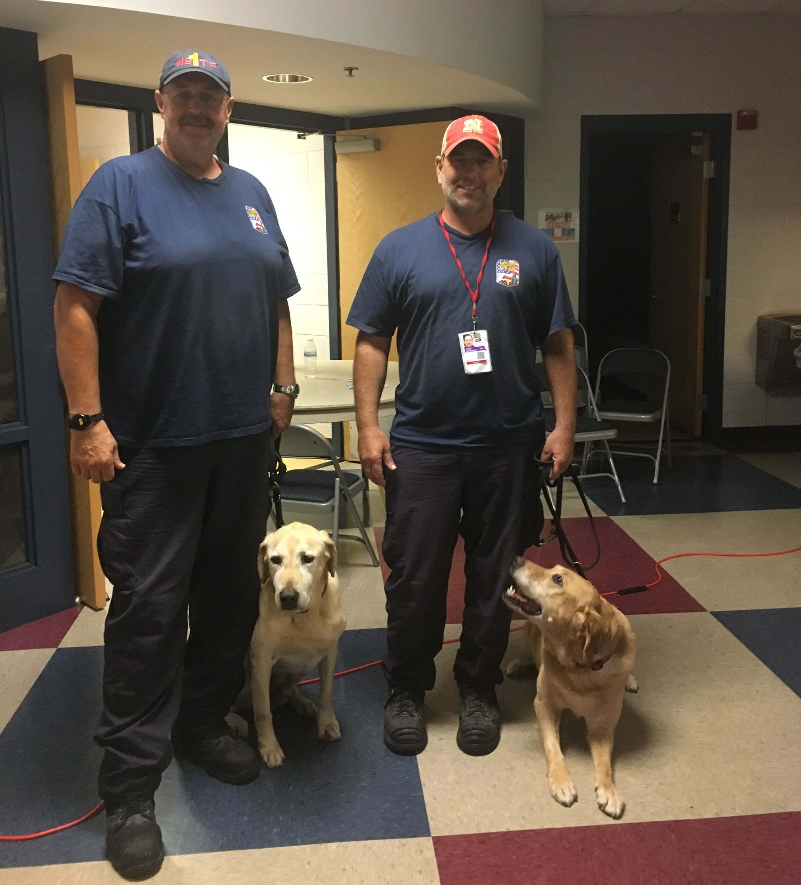 The FEMA rescue team dog handlers and their search dogs. Mark Schroeder and 9-year-old Noah are on the left; Steve MacDonald and 7-year-old Lilly are on the right.