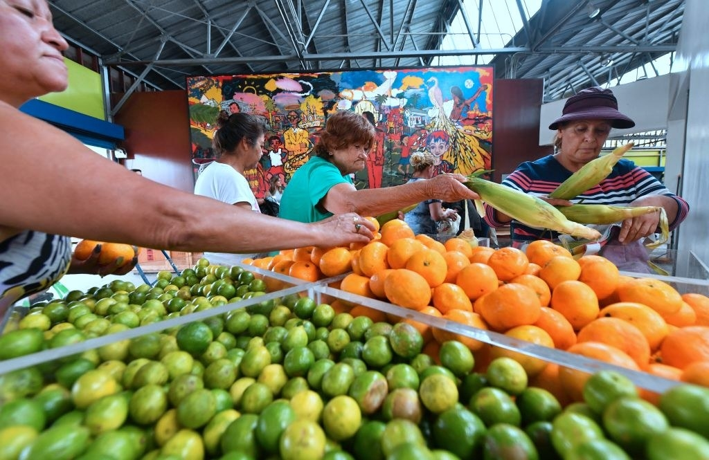 People pick free fruit and vegetables during a food distribution effort on July 18, 2018 in Los Angeles.