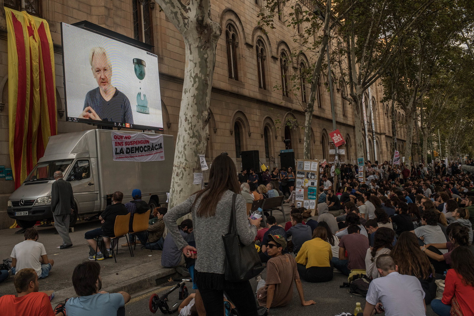 Julian Assange holding a video conference with Catalan students outside the University of Barcelona on Sept. 26, 2017.