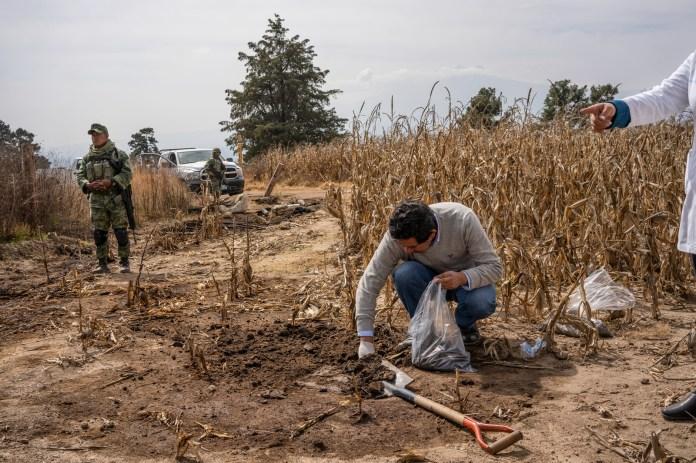 Armando Tapia takes samples of contaminated soil.