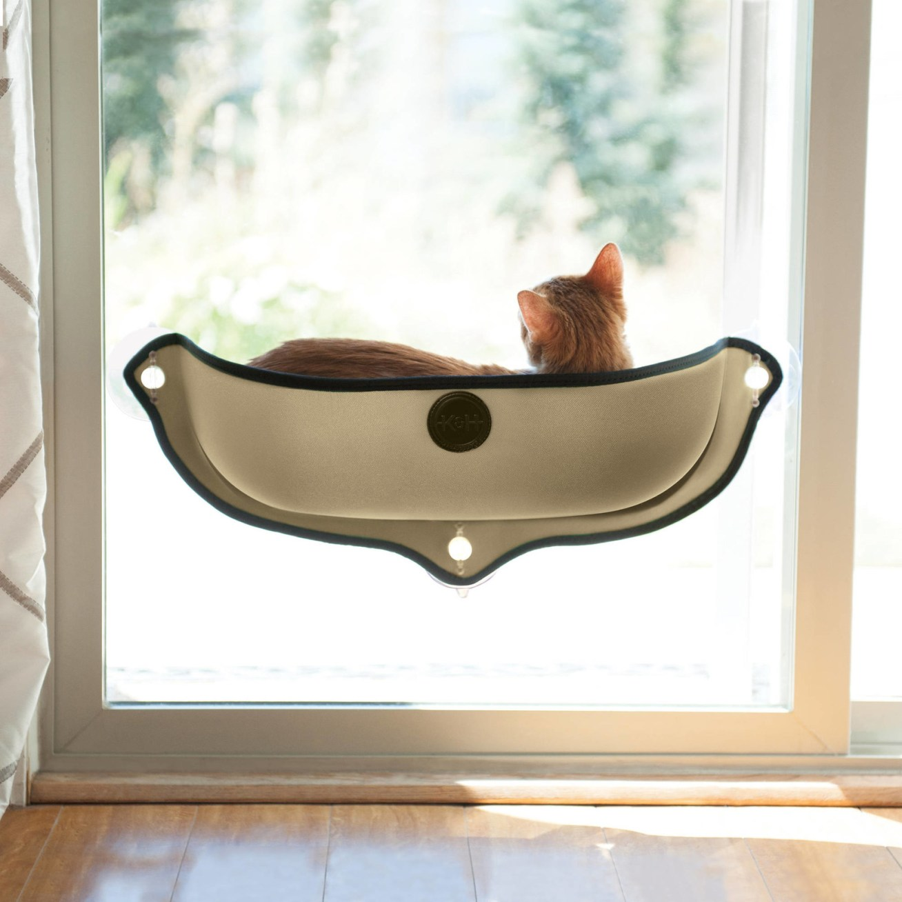 """Promising review: """"My cat George was scared at first to enter the window bed but now he loves it. I think that it is close up to the window and if the window is too cold he doesn't like that. So my son took out the pillow to give him more room."""" —RhondaPrice: .75+ (available in two colors)"""