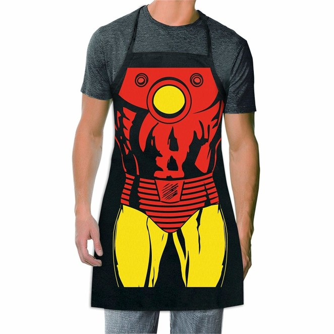 """Even though Tony Stark never needs to cook, he'd probably be good at it if he tried. Promising review: """"I purchased this for my boyfriend for BBQ Sundays. He looks super cute in it, and it's thicker than I thought it would be — really good quality. I have washed it twice, and the picture hasn't faded either! I'm going to buy another for myself so we can be superhero cooks in the kitchen. Great buy if you like Marvel comics."""" —B.ParraGet it from Amazon for $10.19+ (available in 25 designs)."""