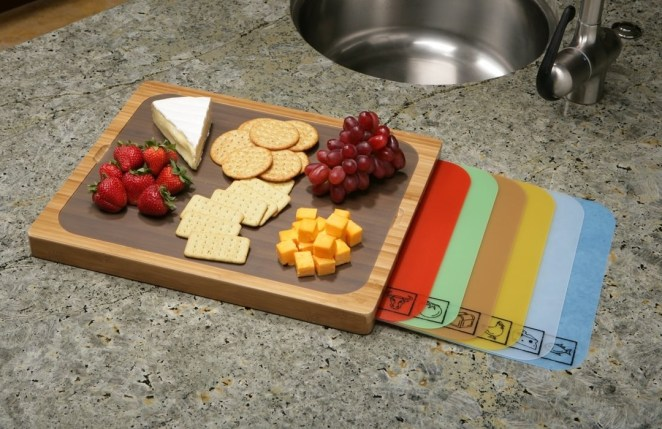 "Well, as long as things don't get too messy. Promising review: ""I absolutely love this cutting board! This board is the best of both worlds: you get a sturdy bamboo base, with interchangeable color-coded covers so you don't cross-contaminate! Plus, they even have cute little icons on them, so you never forget which color is for what kind of food product. Also makes for easier clean-up and the ability to use just one cutting board while preparing a meal, without having to repeatedly wash it between items!"" —PegasusGet it on Amazon for $20.35."