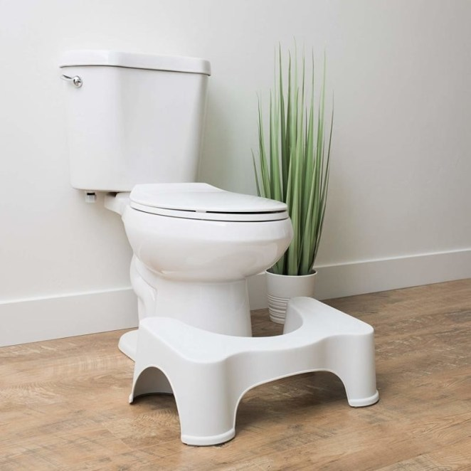 """Promising review: """"I love Squatty Potty and you will too. It works like a charm. You will wonder how you got along without it all these years. Think 'Laundry Chute!' That's the best way I can explain it. You will have more time on your hands once you own a Squatty Potty. You go into the bathroom and you are out in a few minutes, not 10; 15; or 20 minutes as in the past."""" —campromiseGet it on Amazon for $24.99 (or check out the more decorative teak stool for $62.57)."""