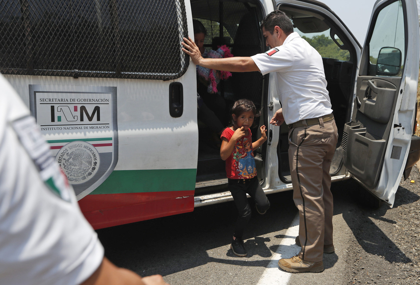 A Central American migrant child cries as she is asked to get into an immigration vehicle as she is detained on the highway to Pijijiapan, Mexico.