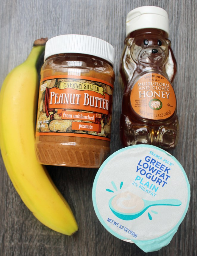 ½ banana, sliced2 tablespoons peanut butter or nut butter of choice4 ounces plain Greek yogurtHoney, agave, or stevia to taste, optional4-5 large ice cubes½ cup milk or water