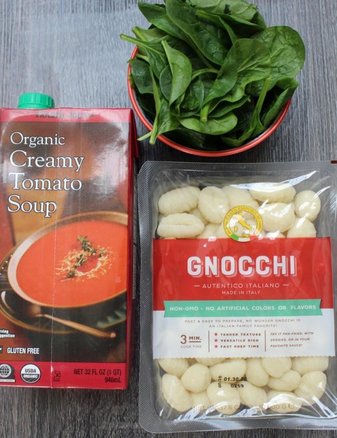 ½ cup store-bought potato gnocchi8 ounces (or more) creamy tomato soupHandful of fresh spinachKosher salt, to tasteFreshly ground black pepper, to tasteOlive oil, to taste1 teaspoon plain Greek yogurt, optional