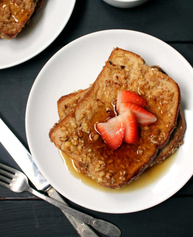 Flaxmeal, walnuts, and vanilla soy milk come together to turn whole wheat toast into this incredibly enticing French toast. Get the appetizing breakfast recipe here.