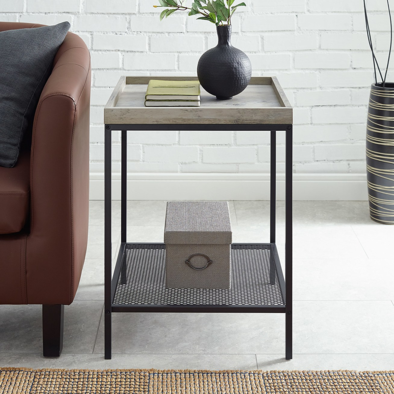 "Promising review: ""I really like this end table! It worked perfectly in my space and I was so glad that it was easy to build. It surprisingly looks more expensive than it is and the wood looks extremely durable. The legs are sturdy and it is overall a great piece."" —citydwellerPrice: .55+ (available in three colors)"