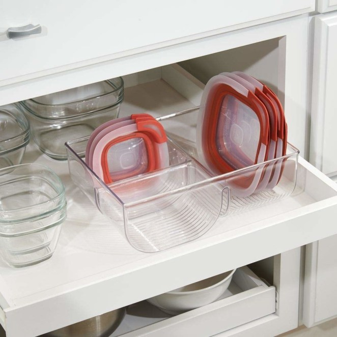 "Promising review: ""A bit pricey for a plastic bin to put my plastic lids into, but it's a perfect size and it's not flimsy! Instantly made my plasticware drawer less frustrating! :) I used museum putty (sticky tack) to help it not slide around."" —EmmyGet it from Amazon for $12.99."
