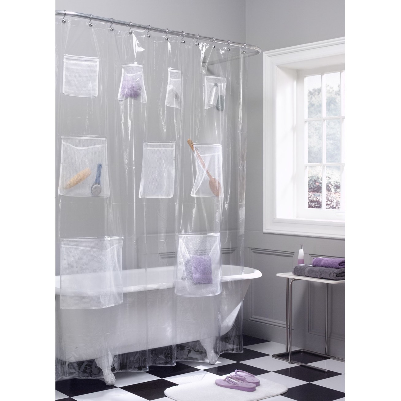 "Promising review: ""Good quality; it has several pockets with two different sizes. It's perfect for organizing and storing bathroom/cleaning/toiletries items. I put my decorative shower curtain in front of it so you don't see anything. It allows me to then have more room under my sink."" —Mommyorganizer