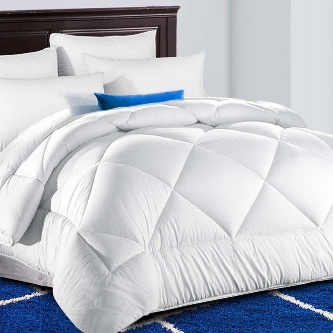 """Promising review: """"Can't say enough good things about this comforter! It is beautiful in color, as well as super soft and cozy! The price made it super affordable for anyone wanting a great piece of inexpensive bedding. I am so happy with this that I purchased a second one for my daughter, and I am considering a third one. Just love it!!"""" —DedewiGet it from Amazon for $39.90+ (available in three colors, and four sizes)."""